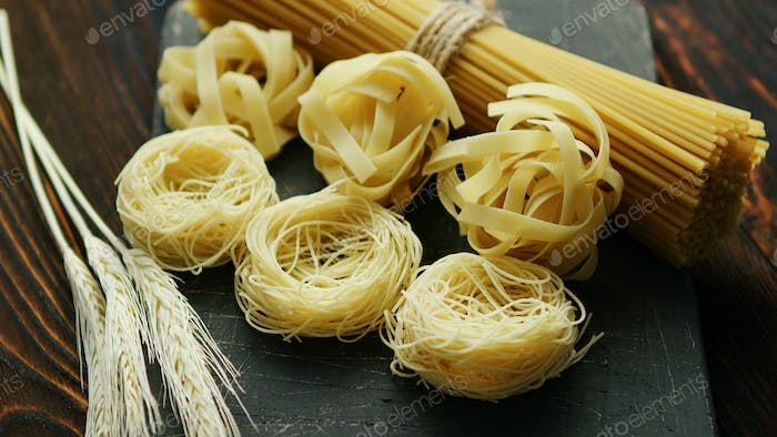 Uncooked spaghetti and wheat