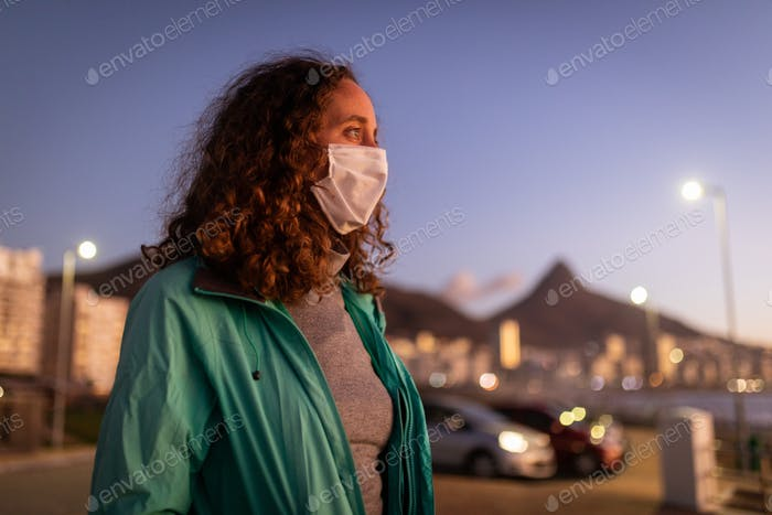 Caucasian woman wearing a protective mask against coronavirus