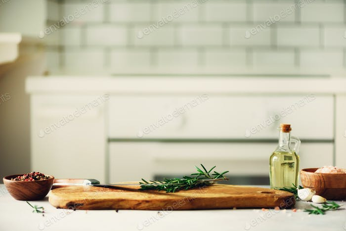 Food cooking ingredients on white kitchen design interior background with rustic wooden chopping