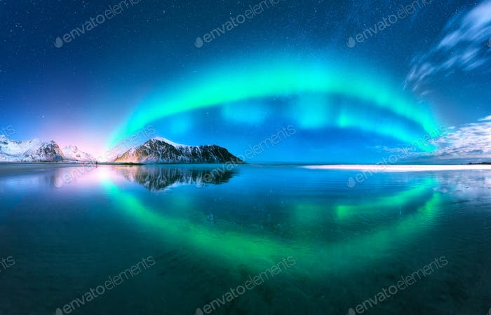 Aurora reflected in water. Northern lights. Norway