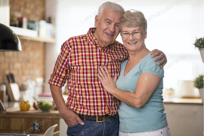 Cheerful senior marriage in the domestic kitchen