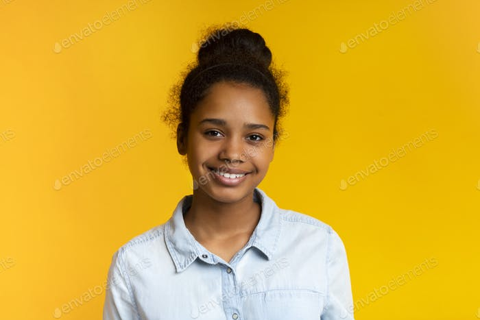 Pretty teen girl smiling and looking at camera
