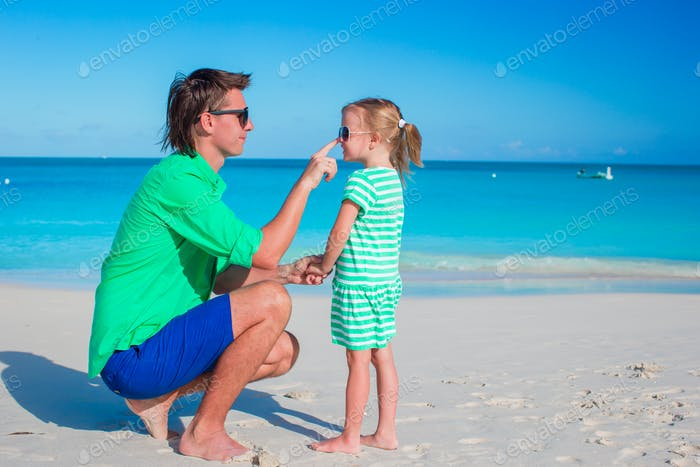 Happy family at tropical beach