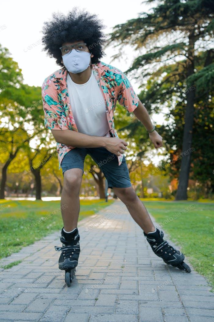 Latin man roller skating outdoors.