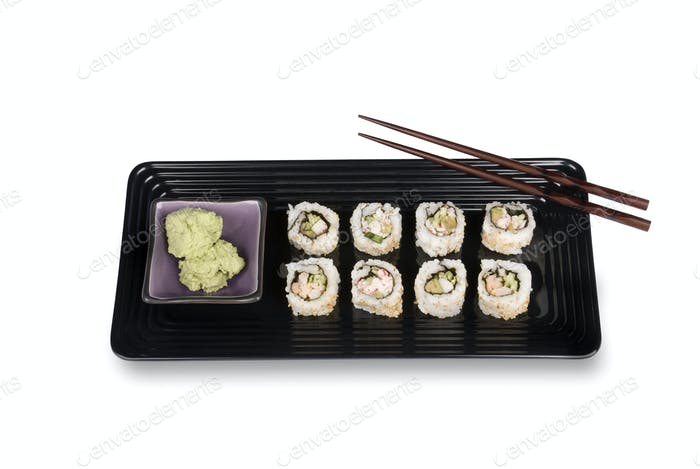 Sushi rolls on plate with chopsticks