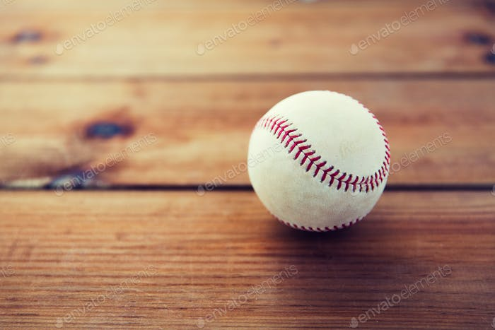 close up of baseball ball on wooden floor