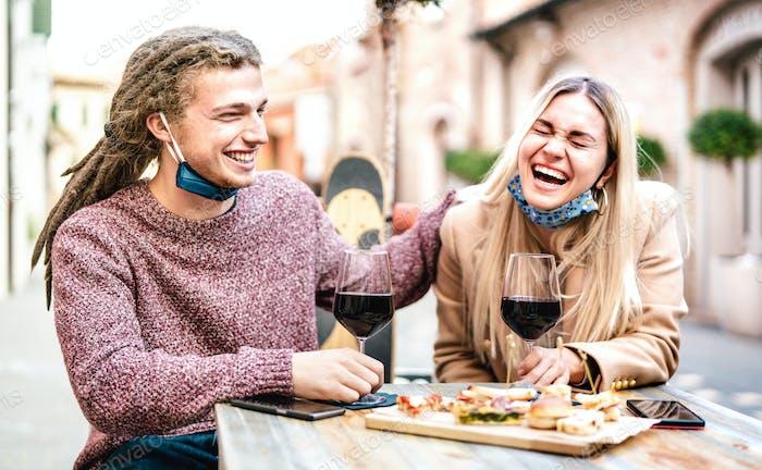 Couple having fun at winery bar