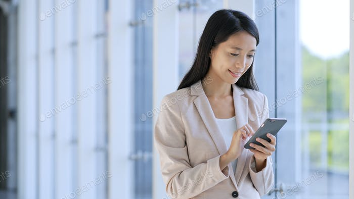 Professional Business woman looking at tablet computer