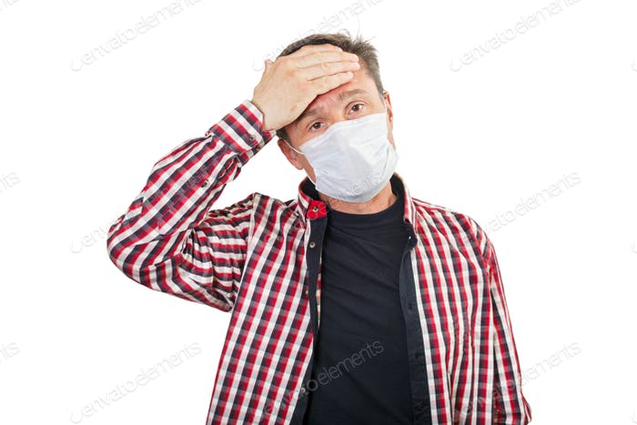 Adult male with a headache in a medical mask