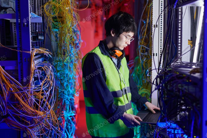 Young Technician Setting Up Internet Network