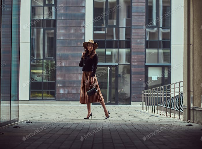 Fashion elegant woman walking on the European city center.
