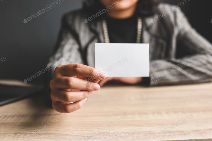 Hand shows name card