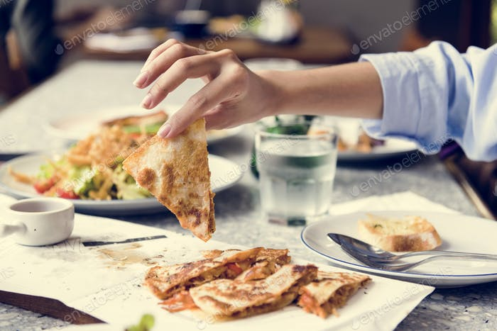 Close up of hand enjoying the food