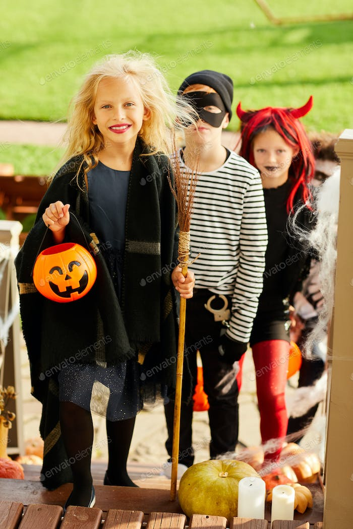 Girl Trick or Treating with Friends