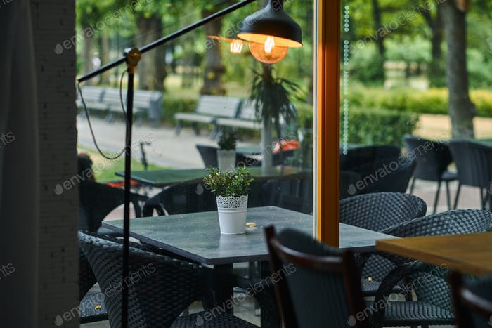 Empty outdoor cafe. Tables and chairs at restaurant terrace.