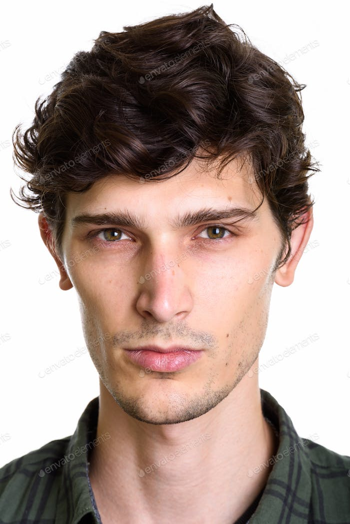 Face of young handsome Hispanic man looking at camera