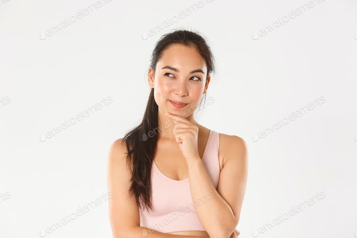 Sport, wellbeing and active lifestyle concept. Close-up of thoughtful asian fitness girl, female