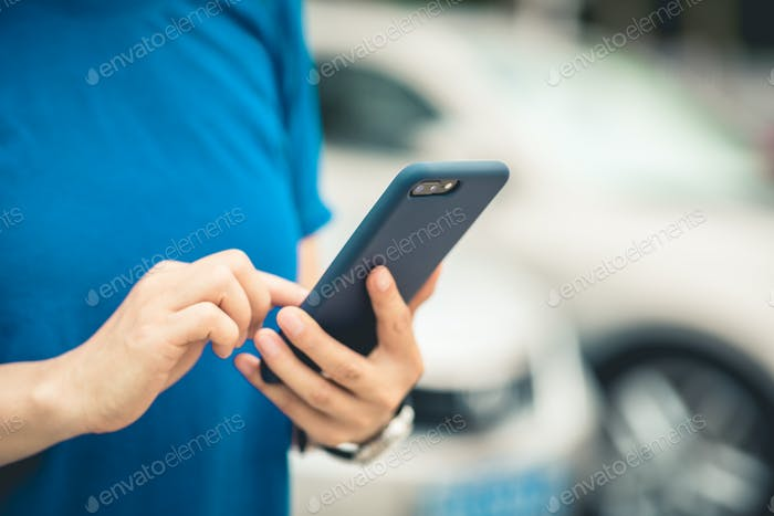 Asian woman using smartphone outdoors