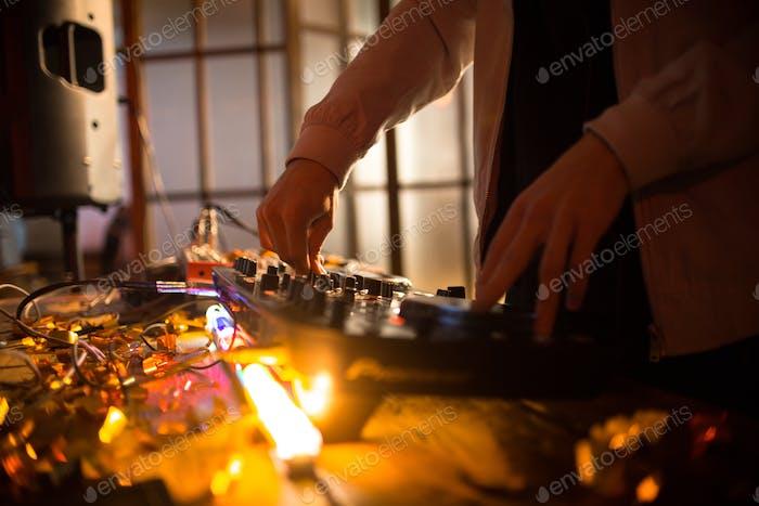 Mixing Music at Night Club