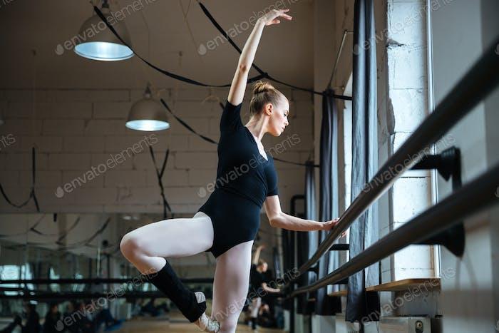 Woman dancing in ballet class