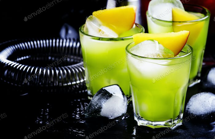 Green cocktail with mango