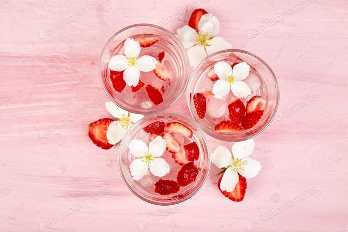 Strawberry detox water with jasmine flower. Summer iced drink