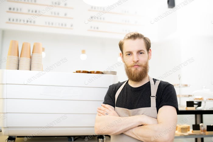 Hipster young barista in coffee shop