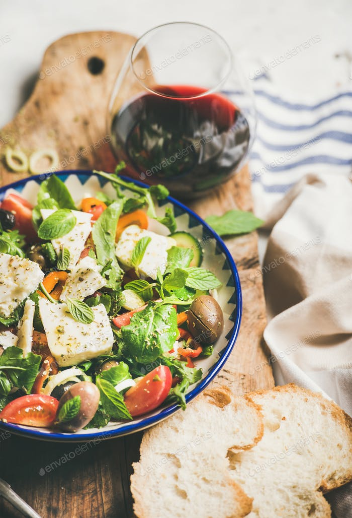 Traditional Greek salad with feta cheese and olives