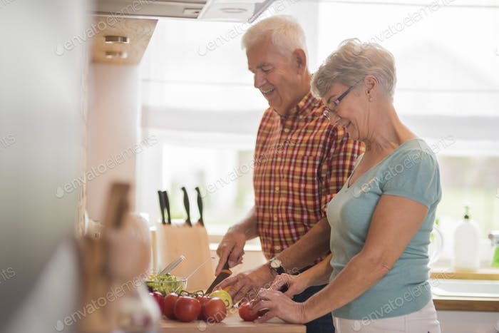 Senior marriage preparing a meal together