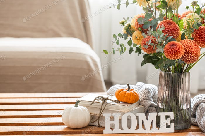 Autumn background with a bouquet of chrysanthemums and pumpkins, copy space.