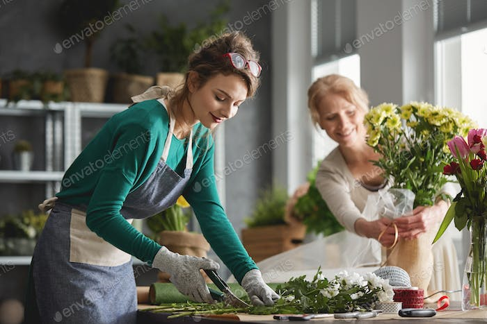Young woman in flower shop