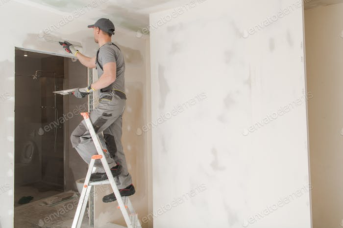 Worker Patching Drywall