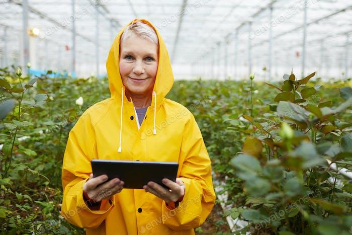 Gardener using tablet pc