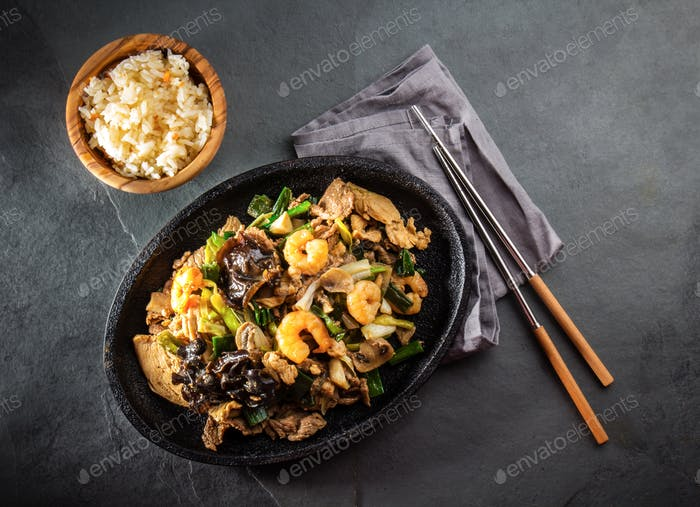 Chinese food. Te pam sao. Pan of fried different meat, shrimps shiitake mushroom