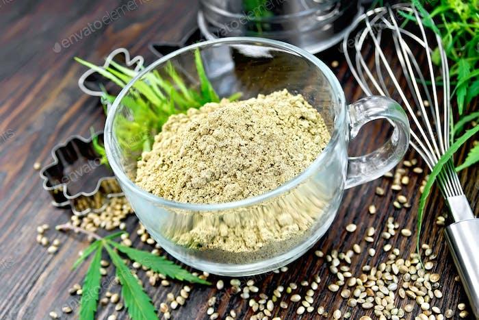 Flour hemp in glass cup on board
