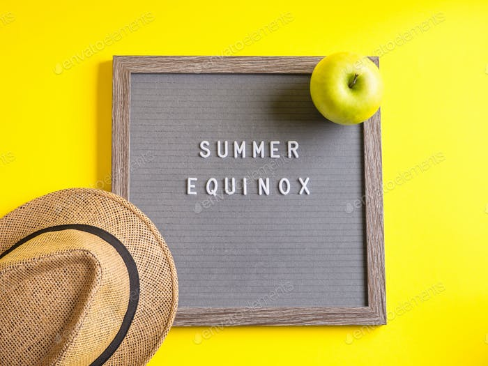 Summer equinox text on letter board on yellow