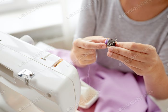 tailor woman with spool of sewing machine