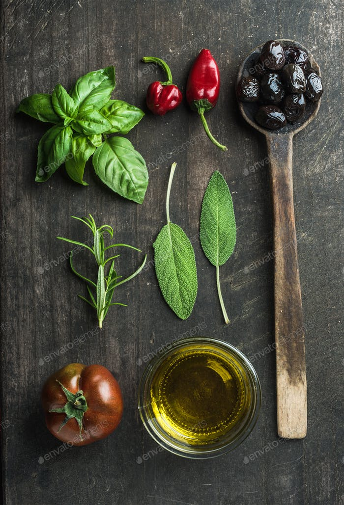 Vegetables and herbs on dark rustic wooden background