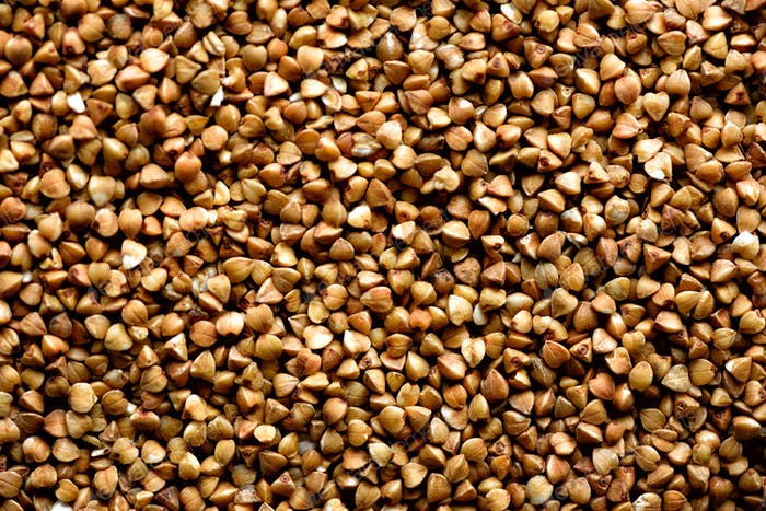 Roasted buckwheat texture. Food ingredient background. Top view, healthy lifestyle concept