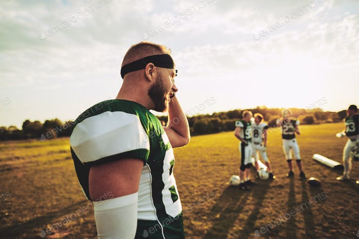 American football player looking tired after a team practice