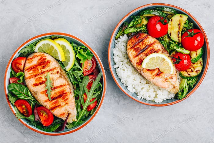 Grilled salmon steak with fresh and baked vegetables and rice