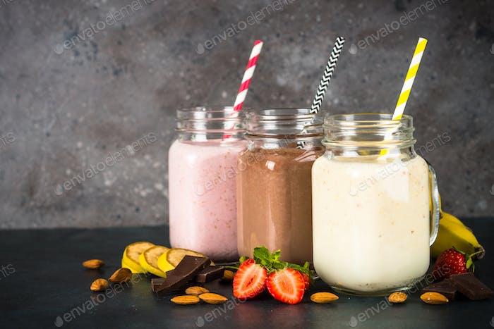 Banana, chocolate and strawberry milkshakes