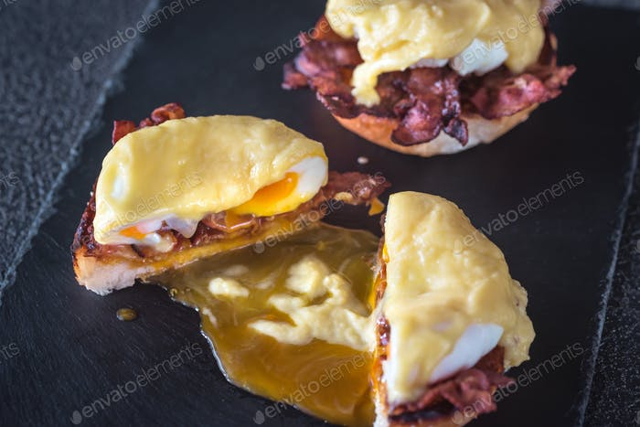 Eggs Benedict on slate tray