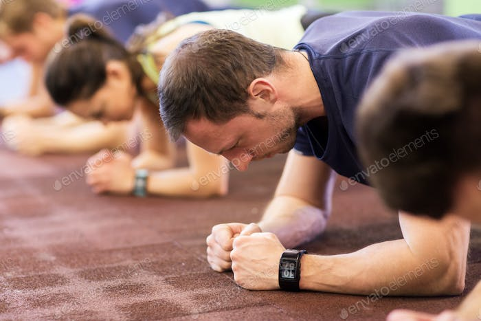 Thumbnail for man with heart-rate tracker exercising in gym
