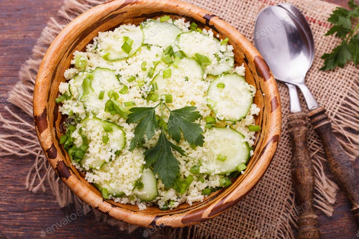 Salad, couscous with cucumber and green onions.