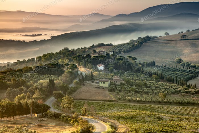 Tuscany foggy hills panorama view