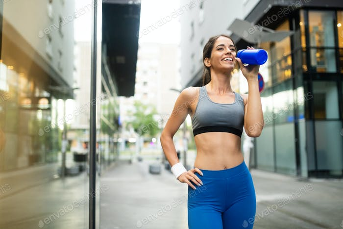 Beautiful happy fit woman running and exercising outdoor