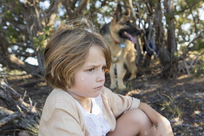 4 year old boy hiking with his German Shepherd