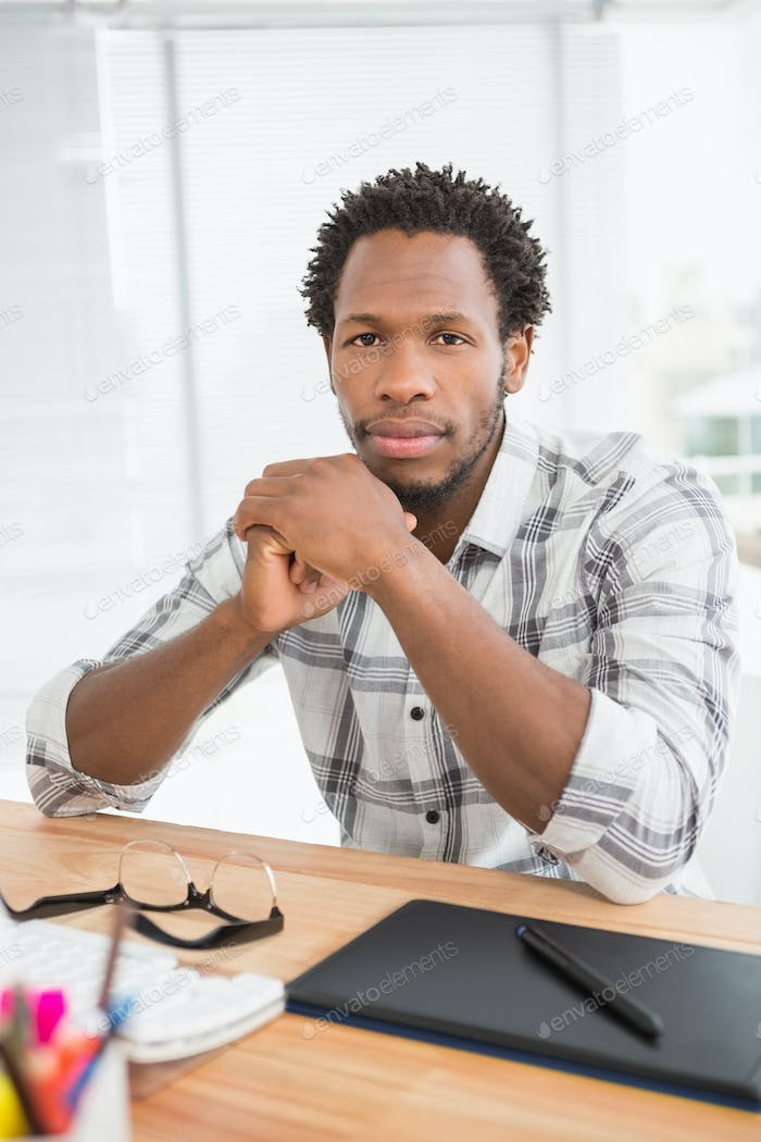 Portrait of concentrated casual businessman looking at camera in the office
