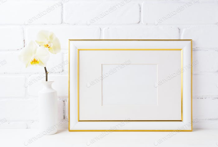 Gold decorated landscape frame mockup with soft yellow orchid in